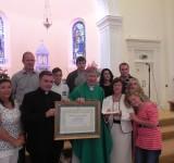 Bishop Presents Award